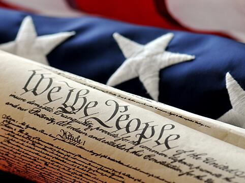 Picture of a portion of the U.S. Constitution and American flag