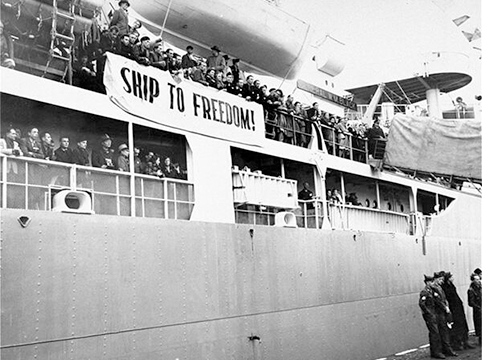 "Image of Displaced persons seeking to immigrate to the U.S. line the decks of the General Black as it leaves the port of Bremerhaven, October 1948. Nicknamed the ""Ship to Freedom"" by its passengers, it brought 813 European Displaced Persons from eleven nations to the U.S. the provisions of the newly enacted Displaced Persons' Act, the first group allowed to enter under the new quota. *United States Holocaust Memorial Museum, courtesy of National Archives and Records Administration, College Park."
