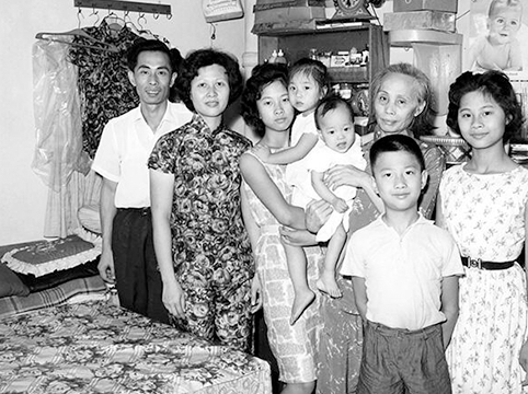 Image of Wong Yick Yuen family, last group of Hong Kong parolees in fiscal year 1963. USCIS History Office and Library. Wong Yick Yuen family, last group of Hong Kong parolees in fiscal year 1963. *USCIS History Office and Library.