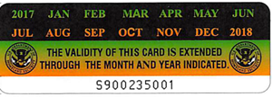USCIS sticker validating the month and year extension of the Permanent Resident Card.