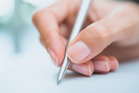Person signing a form