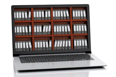 Laptop computer with image of books on the screen