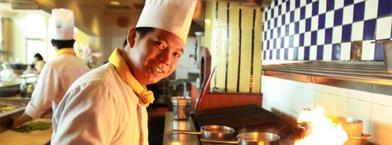Man cooking as a chef in a restaurant